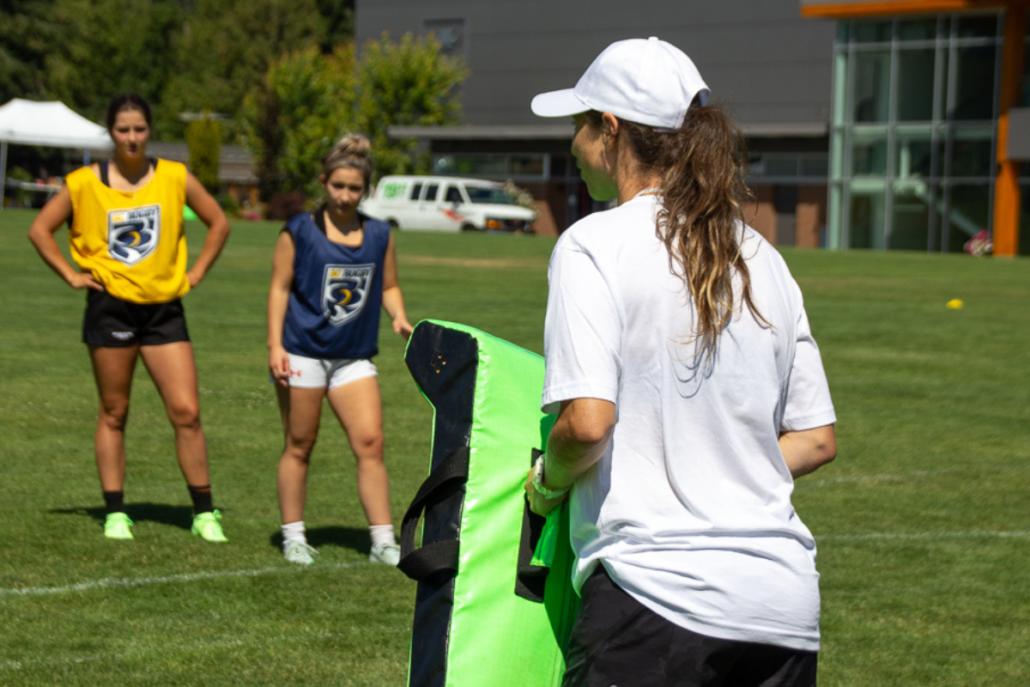 A female coach in session
