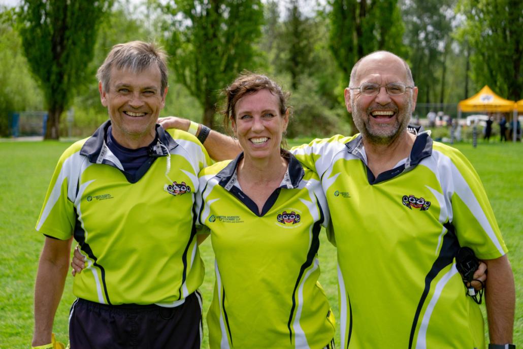 Three referees stood together