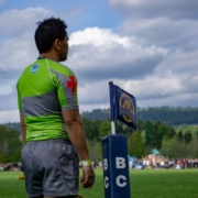 A referee looks on from the line