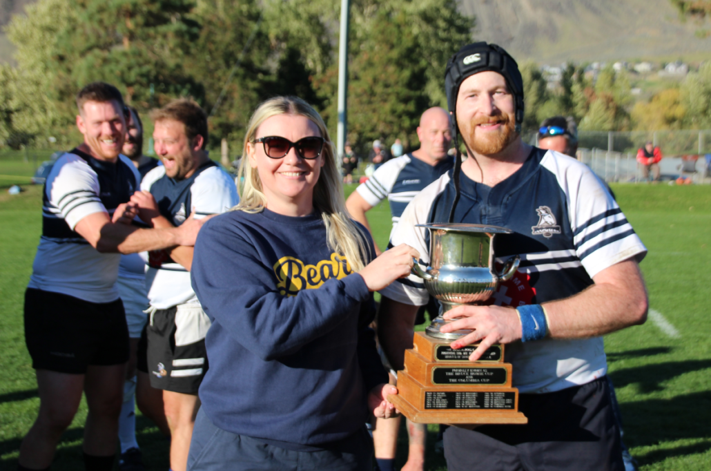 BC Rugby CEO Annabel Kehoe presents the Saratoga Cup to Rocky Mountain Rogues